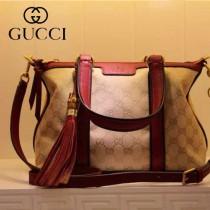 GUCCI 353114-6 古馳新款杏布配棕色皮 單肩斜背包 流蘇手提包