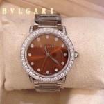 Bvlgari-77 高貴奢華女士新款施華洛世奇水鑽系列電鍍閃亮銀橙色貝母表面鋼帶款腕錶