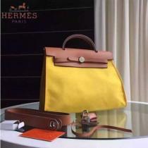 HERMES-0007-2 時尚新款herbag系列原單黃色帆布配土黃色牛皮大號手提單肩包