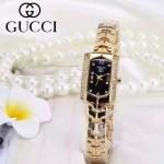 GUCCI-073-3 歐美百搭土豪金鑲鑽黑底316精鋼錶殼進口石英腕錶