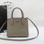 PRADA 1BA071-4 甜美淑女風灰色拼白原版十字紋迷你風琴包